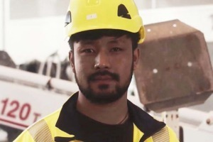 Picture of unaccompanied youth with construction helmet